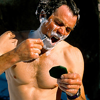 BAFFIN ISLAND, Canada, Alex Lowe washes & shaves in expedition base camp.