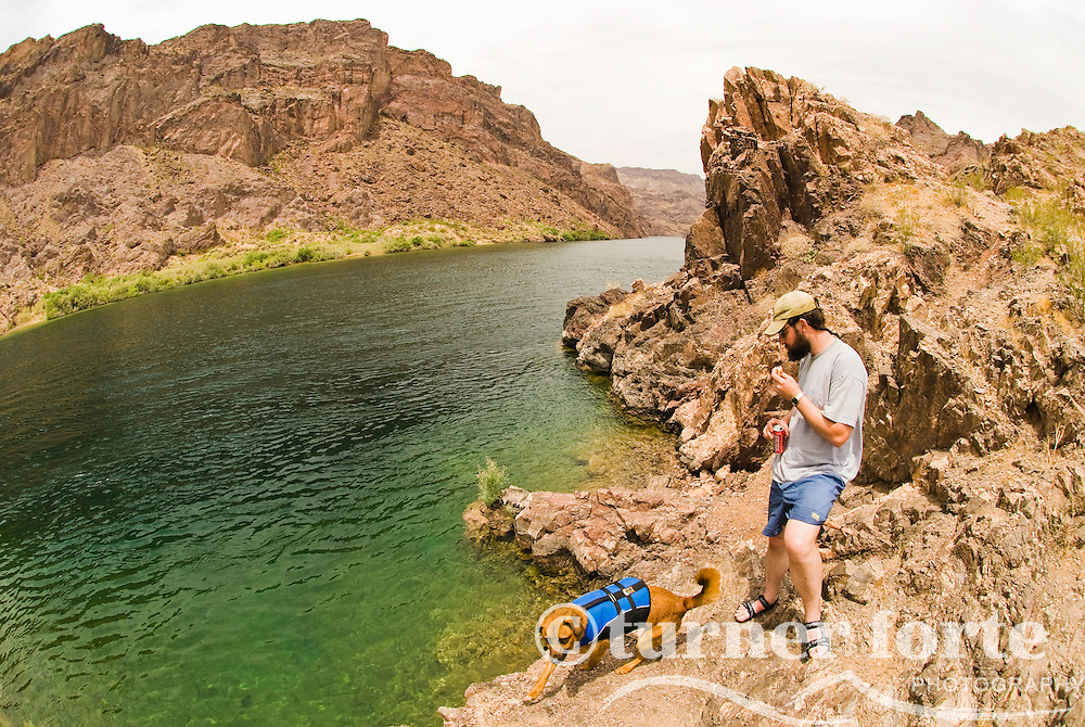 A man views the Colorado River from the cliffs of The Black Canyon, Nevada.