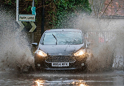 © Licensed to London News Pictures. 09/02/2020. London, UK. A car battling through flooded road in Harefield west of London as Storm Ciara batters the UK. Airlines have cancelled dozens of domestic and international flights as Storm Ciara brings strong winds and rain. Photo credit: LNP