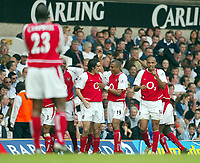 Photo: Scott Heavey.<br /> Tottenham Hotspur v Asrenal. FA Barclaycard Premiership. 25/04/2004.<br /> Sol Campbell gets the thumbs up from Thierry Henry after Arsenal go 2-0 up