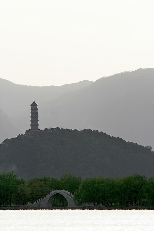A pagoda lies across the Kunming Lake at the Summer Palace.  The Summer Palace is in north west Beijing, China was built in the Jin Dynasty.  The Summer Palace is over 700 acres, 3/4 of which is the Kunming Lake.