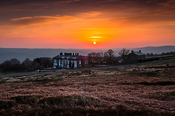 © Licensed to London News Pictures. 25/03/2020. Ilkley UK. The sun rises over the Cow & Calf pub high up on Ilkley Moor in Yorkshire this morning on the second day of the Coronavirus lockdown. Photo credit: Andrew McCaren/LNP