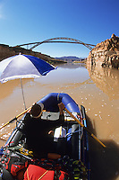 A rafter floats the Colorado River in Glen Canyon National Recreation Area, Utah.