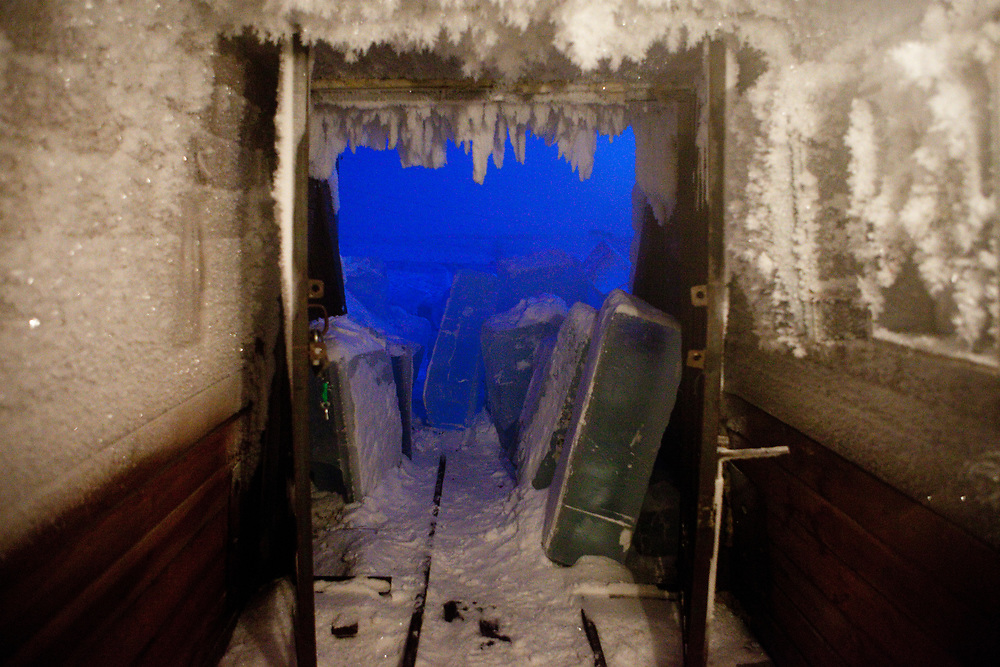 The Pole of Cold. Permafrost cave  which was used in earlier times to store food in the summer - close to the village of Tomtor. The cave has in winter and summer a constant temperature of -10°C or lower . In geology, permafrost or permafrost soil is soil at or below the freezing point of water (0 °C or 32 °F) for two or more years. Ice is not always present, as may be in the case of nonporous bedrock, but it frequently occurs and it may be in amounts exceeding the potential hydraulic saturation of the ground material. Tomtor, Jakutien, Yakutia, Russian Federation, Russia, RUS, 19.01.2010