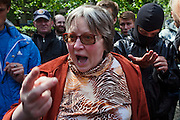Moscow, Russia, 15/05/2012..An angry local resident argues with protesters in Chistiye Prudy, or Clean Ponds, as a Moscow court ordered the eviction of some 200 opposition activists who have set up camp in the city centre park.