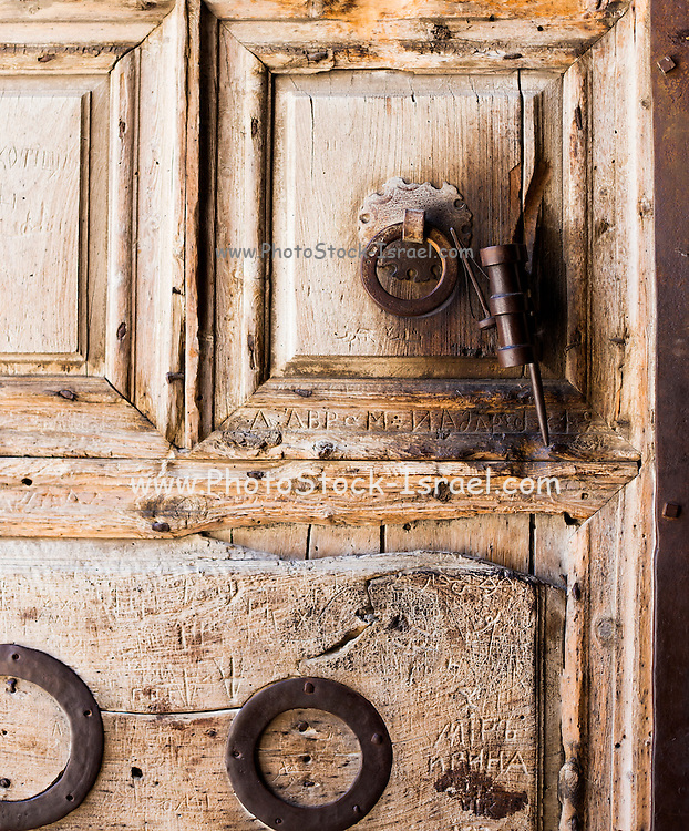 Close up of the wooden entrance gate of the Church of the Holy Sepulchre, Jerusalem Old City, Israel