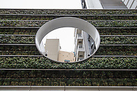 """Green Wall Hiroo Tokyo - Fans of vertical gardens or green walls say governments should provide incentives for green initiatives as they save energy consumption by reducing heat in buildings. Unfortunately, high maintenance costs, expensive building material costs and lack of government support, means they are not widely used and are used more as """"greenwash"""" decorations rather than as a benefits to the environment."""