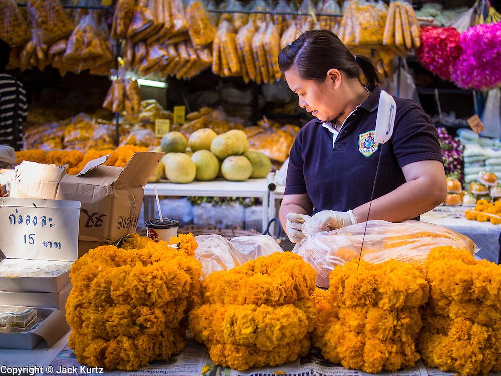 10 JANUARY 2014 - BANGKOK, THAILAND:    A vendor in the flower market in Bangkok.  PHOTO BY JACK KURTZ