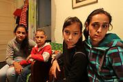 Adriana, ses deux filles et son fils, en 2014 dans leur petit appartement en sous-sol. Adriana est sans emploi et survit grâce aux allocations. Son plus jeune enfant, Ionut, est sourd et muet.<br /> <br /> Adriana and her three children in their basement flat in 2014. Adriana is unemployed and lives on benefits.