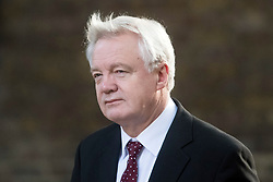 © Licensed to London News Pictures. 12/09/2017. London, UK. Secretary of State for Exiting the European Union DAVID DAVIS arrives at 10 Downing Street in London ahead of a cabinet meeting.  In the early hours of this morning government won a vote in Commons passing the EU repeal bill, by a margin of 326 to 290 votes. Photo credit: Ben Cawthra/LNP