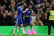 Bertrand Traore of Chelsea (c) celebrates after scoring his sides 5th goal to make it 5-1 with Willian of Chelsea and Oscar of Chelsea. The Emirates FA Cup, 5th round match, Chelsea v Manchester city at Stamford Bridge in London on Sunday 21st Feb 2016.<br /> pic by John Patrick Fletcher, Andrew Orchard sports photography.