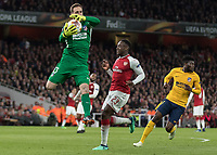 Football - 2017 / 2018 UEFA Europa League - Semi-Final, First Leg: Arsenal vs. Atletico Madrid<br /> <br /> Jan Oblak (Atletico Madrid) gathers the ball in mid air before Danny Welbeck (Arsenal FC) can reach the ball at The Emirates.<br /> <br /> COLORSPORT/DANIEL BEARHAM