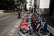 London Cycle Hire bicycles at a docking station in London, England, United Kingdom. The scheme, sponsored by Santander is intended to get Londoners cycling. As part of a major initiative. These bikes are charged for how long you use them. Take a cycle, ride it where you like, then return it, ready for the next person. Available 24 hours a day, all year round. Its self-service and theres no booking. Just turn up and go.