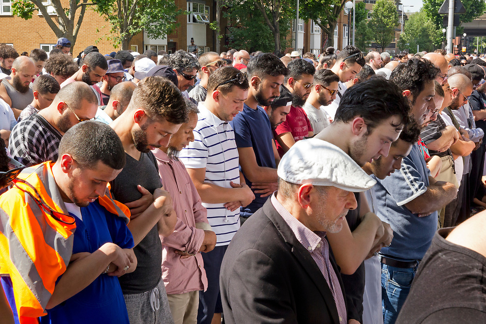 18 June 2017 taken between the hours of 15.38 - 18.11<br /> <br /> With temperatures of almost 30C -hundreds of mourners from the local community joined together in solidarity for an outdoor prayer service held by a group from the local mosque. Muslims came out to honour the dead despite being in the middle of Ramadan.