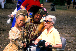 Stock photo of two dwarves posing with a woman at the Texas Renaissance Festival in Plantersville Texas