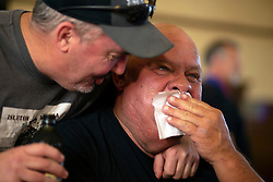 """""""Spam King"""" Paul Steele, right, gets a congratulatory hug from Robert McGahey after eating an entire loaf of Spam at the 22nd annual Spam Festival, Sunday, Feb. 16, 2019, in Isleton, Calif. Spam lovers competed for prizes by presenting their favorite Spam-infused foods, or entering the Spam-eating and Spam-toss contests. (Photo by D. Ross Cameron)"""