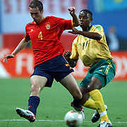 South Africa's Jabu Pule and Spain's Ivan Helguera