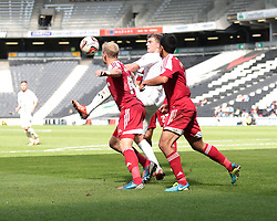 Milton Keynes Dons' Patrick Bamford is challenged by Swindon Town's Massimo Luongo and Swindon Town's Jay McEveley  - Photo mandatory by-line: Nigel Pitts-Drake/JMP - Tel: Mobile: 07966 386802 07/09/2013 - SPORT - FOOTBALL -  Stadium MK - Milton Keynes - Milton Keynes V Swindon Town - Sky Bet League one