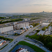 Kansas City, Kansas - 7th Street/Rainbow Boulevard intersecting Southwest Boulevard; grain storage silo with train line; early morning aerial view.