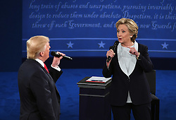 ST. LOUIS, Oct. 10, 2016 (Xinhua) -- Democratic presidential candidate Hillary Clinton (R) and Republican presidential candidate Donald Trump hold the second presidential debate at Washington University in St. Louis, Missouri, the United States, Oct. 9, 2016. The second of three U.S. presidential debates between the Democratic and Republican nominees Hillary Clinton and Donald Trump was held in Washington University on Sunday. (Xinhua/Yin Bogu) (wtc) (Credit Image: © Yin Bogu/Xinhua via ZUMA Wire)