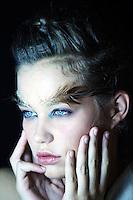 A model backstage before the Bianca Spender Spring/Summer 2010 runway show during Rosemount Australian Fashion Week.