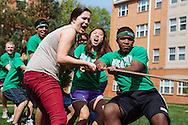 Sophomore Melanie Reeves (from left), junior Nancy Ye and sophomore Greg Opara compete in a game of tug-of-war during Residential College Olympics at Washington University in St. Louis.