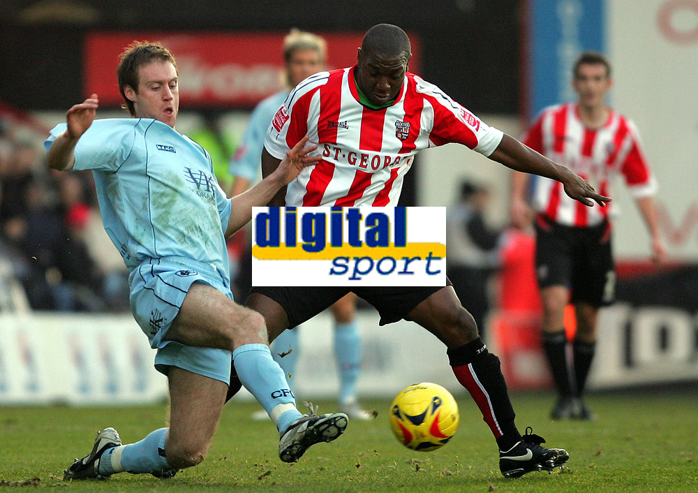 Photo: Frances Leader.<br />Brentford v Chesterfield. Coca Cola League 1. <br />10/12/2005.<br />Chesterfield's Alan O'Hare (L) tackles Brentford's Isaiah Rankin