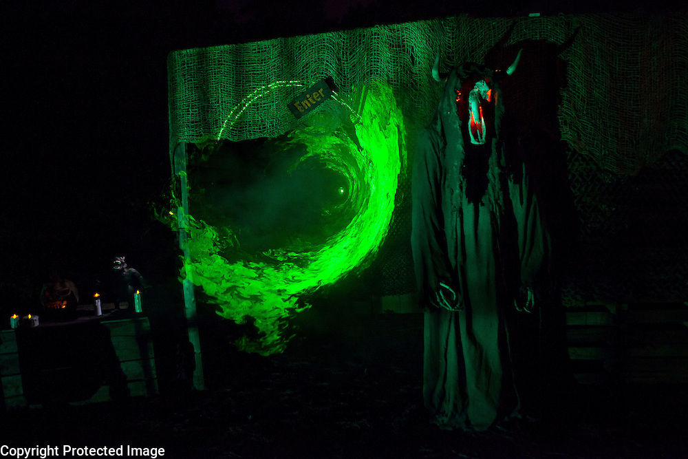 """A red-eyed reaper stands at the entrance to Chris Baker's haunted yard in South Yarmouth, MA. Every year Baker sets up an elaborate Halloween display in his yard and on Halloween, neighborohood residents walk through his frightening """"vortex"""" of horror while trick or treating."""