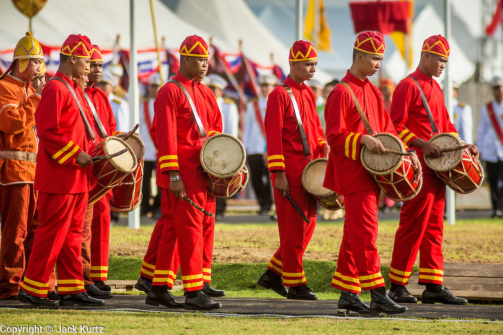 13 MAY 2013 - BANGKOK, THAILAND: Musicians of the Royal Court start the Royal Ploughing Ceremony in Bangkok. The Royal Plowing Ceremony is held Thailand to mark the traditional beginning of the rice-growing season. The date is usually in May, but is determined by court astrologers and varies year to year. During the ceremony, two sacred oxen are hitched to a wooden plough and plough a small field on Sanam Luang (across from the Grand Palace), while rice seed is sown by court Brahmins. After the ploughing, the oxen are offered plates of food, including rice, corn, green beans, sesame, fresh-cut grass, water and rice whisky. Depending on what the oxen eat, court astrologers and Brahmins make a prediction on whether the coming growing season will be bountiful or not. The ceremony is rooted in Brahman belief, and is held to ensure a good harvest. A similar ceremony is held in Cambodia.    PHOTO BY JACK KURTZ