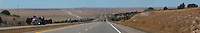 Interstate 20 in rural arid flat eastern New Mexico stretches to the horizon