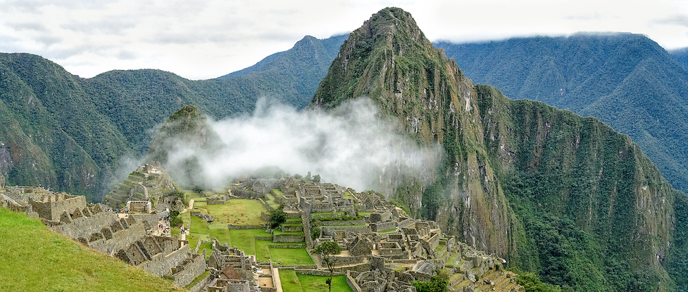 Low clouds over mountains of the sacred valley and Machu Picchu Inca ruins