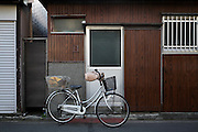 old 1950s style reditential house with bicycle parked in front