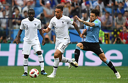 France's N'Golo Kante and Corentin Tolisso and Uruguay's Nahitan Nandez during the FIFA World Cup 2018 Round of 8 France v Uruguay match at the Nizhny Novgorod Stadium Russia, on July 6, 2018. France won 2-0. Photo by Christian Liewig/ABACAPRESS.COM