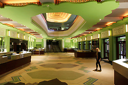 © Licensed to London News Pictures 06/09/2013<br /> Interior of the newly lobby and bar of the 1930s Hammersmith Apollo, now renamed, the Eventin Apollo. <br /> The 1932 Art Deco building was designed by renowned theatre architect Robert Cromieand has been the venue for artists like David Bowie's Ziggy Stardust, Bruce Springsteen, The Rolling Stones, Bob Marley, Ella Fitzgerald and Duke Ellington. <br /> The Eventim Apollo will open to the public on 7th September with a sold-out show for Selena Gomez.
