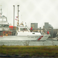 (PPAGE1) Sandy Hook 10/16/2002   A US Coast Guard rescue boat returns and more at Station Sandy Hook after being dispatched into service to rescue a windsurfer in trouble in Raritan Bay ( Adjacent to Highlands Area)  Michael J. Treola Staff Photographer......MJT