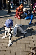 """Cosplayers dressed up as characters from the anime """"NEON GENNESIS EVANGELION"""". """"Rei"""" (L), """"Atsuka"""" (C) & """"Kaoru"""" (R). TOKYO COMIC MARKET """"COMIKET"""" the biggest comic market in Japan. Independent designers come to sell their comics, there is anime, manga, cosplay, toys, posters etc. At """"Tokyo Big Sight"""" exhibition center."""