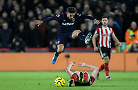 West Ham United's Manuel Lanzini hurdles the challenge from Sheffield United's John Lundstram<br /> <br /> Photographer Rich Linley/CameraSport<br /> <br /> The Premier League - Sheffield United v West Ham United - Friday 10th January 2020 - Bramall Lane - Sheffield <br /> <br /> World Copyright © 2020 CameraSport. All rights reserved. 43 Linden Ave. Countesthorpe. Leicester. England. LE8 5PG - Tel: +44 (0) 116 277 4147 - admin@camerasport.com - www.camerasport.com