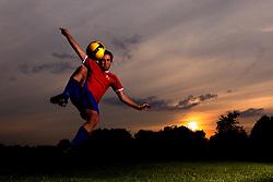 A man volleys a football