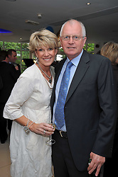 MR & MRS MICK CHANNON at the launch of the 2009 Derby Festival in the presence of HRH Princess Haya of Jordan in aid of the charity Starlight held at the Kensington Roof Gardens, 99 Kensington High Street, London W8 on 12th May 2009.