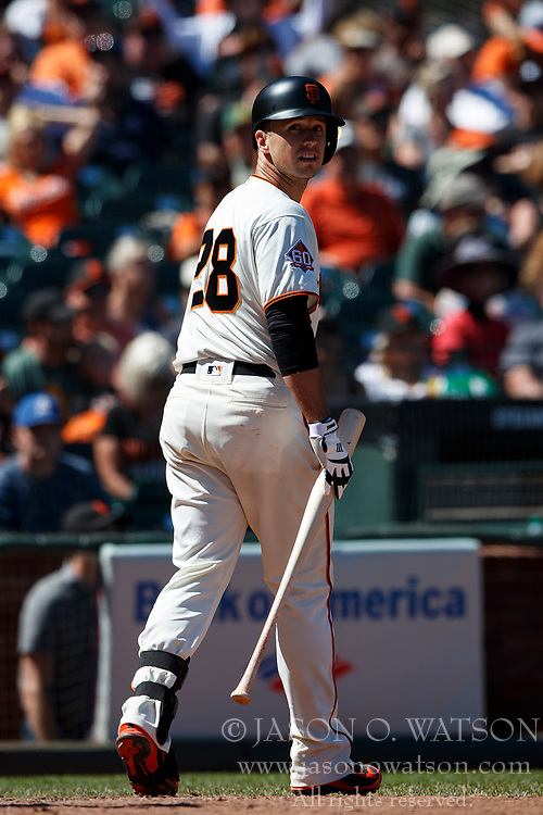 SAN FRANCISCO, CA - JULY 15: Buster Posey #28 of the San Francisco Giants returns to the dugout after striking out against the Oakland Athletics during the ninth inning at AT&T Park on July 15, 2018 in San Francisco, California. The Oakland Athletics defeated the San Francisco Giants 6-2. (Photo by Jason O. Watson/Getty Images) *** Local Caption *** Buster Posey