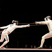 TOKYO, JAPAN - JULY 30:  Koki Kano of Japan (left) in action against Sergey Bida of ROC during the Japan V ROC gold medal match won by Japan 45-36  during the fencing epee team event for men at the Makuhari Messe at the Tokyo 2020 Summer Olympic Games on July 30, 2021 in Tokyo, Japan. (Photo by Tim Clayton/Corbis via Getty Images)