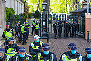 London, United Kingdom, May 22, 2021: Police standing guard during a pro-Palestinian rally outside the Israeli Embassy Kensington, central London on Saturday, May 22, 2021. Egyptian mediators held talks Saturday to firm up an Israel-Hamas cease-fire as Palestinians in the Hamas-ruled Gaza Strip began to assess the damage from 11 days of intense Israeli bombardment. (Photo by Vudi Xhymshiti/VXP)