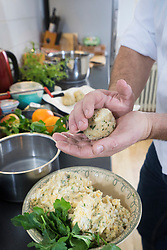Cook preparing dumplings in private kitchen