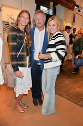Left to right, ALICE HARVEY, HENRY CHAPLIN and SAM HAYWORTH at a party to celebrate the publication of India Hicks: Island Style hosted by Princess Marie-Chantal of Greece, Saffron Aldridge and Amanda Brooks has held at Ralph Lauren, 105-109 Fulham Road, London on 28th April 2015,