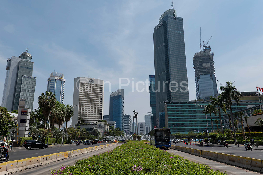 Central Jakarta skyline with the Selamat Datang monument on the horizon on the 21st October 2019 in Java in Indonesia