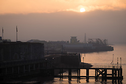 © Licensed to London News Pictures. 30/12/2016. Portsmouth, UK.  The sun makes a brief appearance and is seen rising above the fog. People on the South Coast have woken up to foggy weather this morning, 30th December 2016. Photo credit: Rob Arnold/LNP