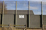 The external wall the Guys Marsh prison has anti drug signs around the perimeter discouraging people from throwing drugs over into the prison. HMP Guys Marsh is a category C prison in Dorset housing 578 prisoners.