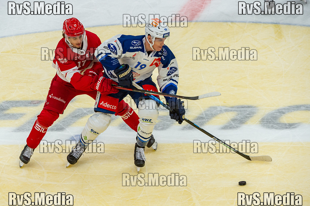 LAUSANNE, SWITZERLAND - OCTOBER 01: Ken Jager #17 of Lausanne HC battles for the puck with Reto Schappi #19 of ZSC Lions during the Swiss National League game between Lausanne HC and ZSC Lions at Vaudoise Arena on October 1, 2021 in Lausanne, Switzerland. (Photo by Robert Hradil/RvS.Media)