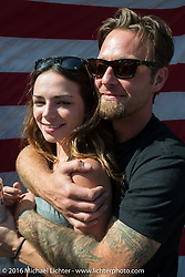 "Jason Moffit hugs Allison Gantt at Willie's Tropical Tattoo ""Chopper Time"" old school chopper show during Daytona Bike Week's 75th Anniversary event. Ormond Beach, FL, USA. Thursday March 10, 2016.  Photography ©2016 Michael Lichter."
