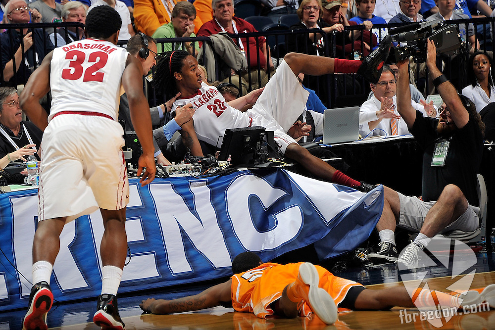 NASHVILLE, TN - MARCH 15:  Levi Randolph #20 of the Alabama Crimson Tide crashes into the media table during a game against the University of Tennessee Volunteers during the Quarterfinals of the SEC Tournament at the Bridgestone Arena on March 15, 2013 in Nashville, Tennessee.  (Photo by Frederick Breedon/Getty Images)